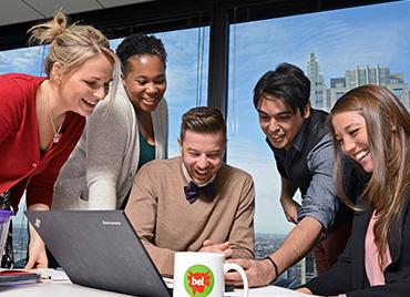 Bel employees in office w/ computer