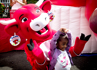 Child w/ The Laughing Cow mascot