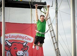 Bel employee on trapeze